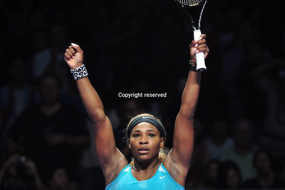 20.10.2014. Singapore.  Serena Williams of the United States celebrates after winning the the round robin match of the WTA Tennis Womens Finals against Serbias  Ana Ivanovic at the Singapore Indoor Stadium, Oct. 20, 2014. Serena Williams won 2 to 0.