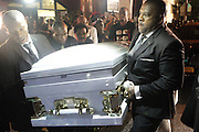 New York, NY- July 23: Eric Garner's Casket is carried to waiting hearse at his funeral. Eric Garner, who fell victim to tactics of the NYPD died after NYPD Officers rendered him in chokehold on July 20, 2014 in Staten Island. His funeral was held on July 23, 2014 at Bethel Baptist Church in New York City.  (Terrence Jennings)