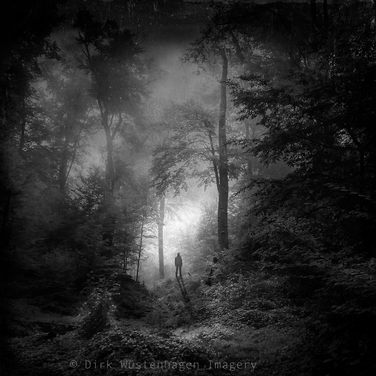 Single person standing in a dark forest scene. Manipulated texturized photograph.<br />