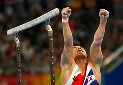 South Korea's Yoo Wonchul celebrates after competing on the parallel bars of artistic gymnastics apparatus finals during the Olympic games in Beijing, China, 19 August 2008. Yoo won the silver for the event.