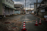 A time capsule in Fukushima's nuclear no-entry zone.  Futaba, the closest village to Fukushima Daiichi Nuclear Power Plant took the full brunt of the radioactive cloud released during the meltdown in March 2011 and remains not only too radioactive for human habitation but it is considered a zone where residents will not be able to live for a long time because the additional annual dose of radiation would be 50 millisieverts/year.  (According to the IAEA (International Atomic Energy Agency), the average annual dose of radiation from natural sources is 2.4 millisieverts/year.  That figure can be, on average, roughly doubled when medical, commercial and industrial activites are factored in.)