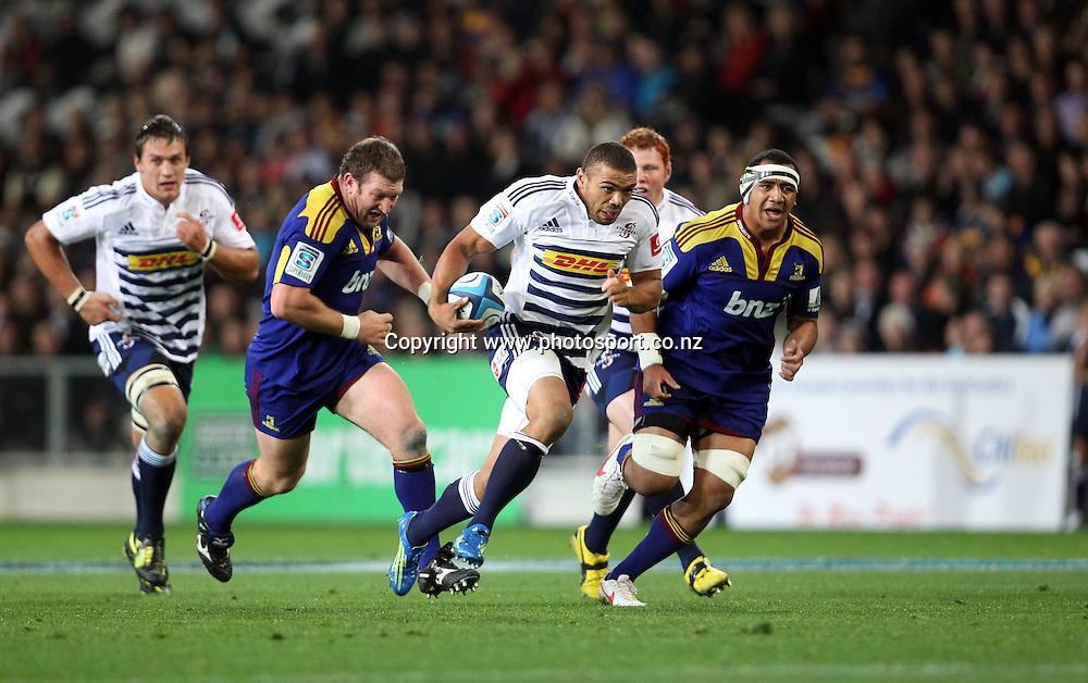 Bryan Habana busts the Highlanders defence.<br /> Investec Super Rugby - Highlanders v Stormers, 7 April 2012, Forsyth Barr Stadium, Dunedin, New Zealand.<br /> Photo: Rob Jefferies / photosport.co.nz