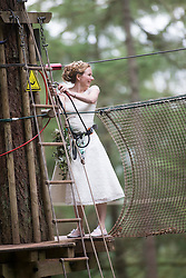 Colette Gregory on the rope in the trees at Go Ape Aberfoyle, heading to the wedding.