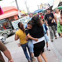 A woman carries her young sleeping son on the streets of Matamoros, Mexico on April 23, 2010. Matamoros has long been controlled by drug cartels and of late the city has been besieged by violence between cartels vying for control of the lucrative drug trade. (Photo/Scott Dalton)