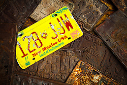 A colloection of New Mexico license plates at Classical Gas in Embudo.
