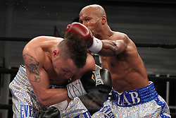 Mar 24; Brooklyn, NY, USA; Zab Judah (Silver/Blue trunks) and Vernon Paris (Silver trunks) trade punches during their 12 round IBF Jr. Welterweight title eliminator at the Aviator.