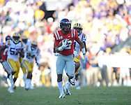 Ole Miss wide receiver Donte Moncrief (12) escapes LSU safety Eric Reid (1) to score on a 46 yard play at Tiger Stadium in Baton Rouge, La. on Saturday, November 17, 2012.....