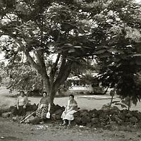 Women waiting for a bus, Fogapoa, Savai'i, Samoa.