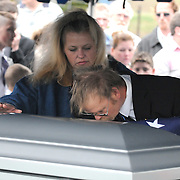 Joe Imel/Daily News.Toney (right) and Shirley Gorham, of Woodburn, stop to kiss the casket of their son PFC Brian Gorham at his burial Tuesday at Hillsdale Cemetery. A native of Woodburn, Gorham died Dec. 31 of wounds he suffered when his Humvee rolled over a roadside bomb in Afghanistan on Dec. 13.