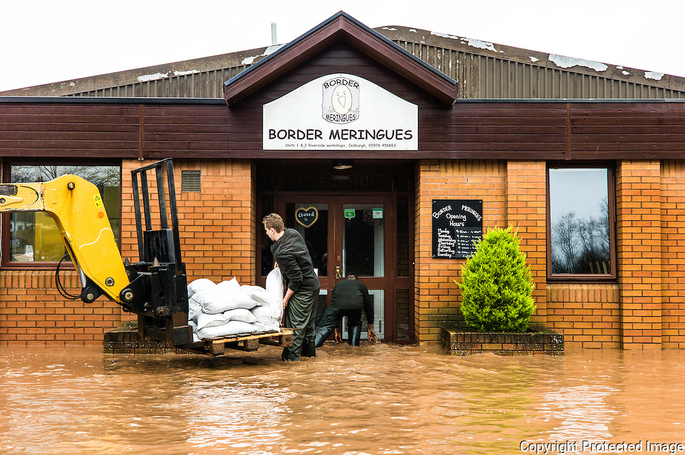 Jedburgh, Scottish Borders, UK. 27th January 2016. Local businesses put sandbags out on Edinburgh Road in Jedburgh after flooding. The area recieved intense torrential rainfall on Wednesday morning.