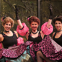 "Linda Larson, left, Lynn O'Connell, center, and Kate Muhlstein pose for a portrait in costume before rehearsal of the production ""The Merry Widow"" Thursday July 17, 2014 at The Cultural Art building on the campus of UNCW. (Jason A. Frizzelle)"