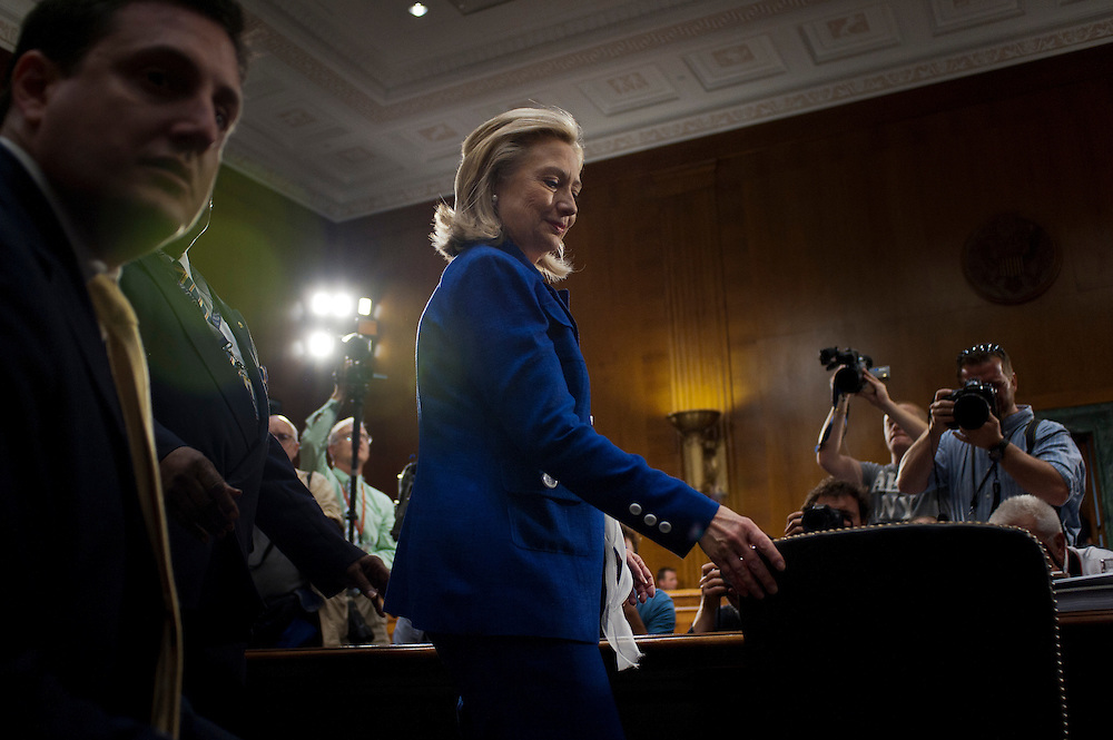 """Secretary of State HILLARY CLINTON arrives to testify before the Senate Foreign Relations Committee during a hearing on """"Evaluating Goals and Progress in Afghanistan and Pakistan."""""""