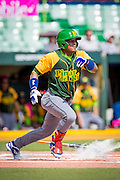 SAN JUAN, PUERTO RICO FEBRUARY 2: A player for Cuba gets a hit during the game against Mexico on February 2 , 2015 in San Juan, Puerto Rico at Hiram Bithorn Stadium (Photo by Jean Fruth)
