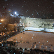 View of the Western Wall in Jerusalem's Old City seen  on a snowy night. December 14, 2013.  Photo by Oren Nahshon