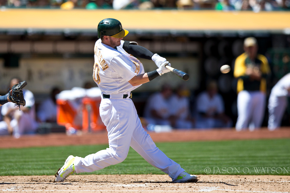 OAKLAND, CA - MAY 26:  Josh Donaldson #20 of the Oakland Athletics hits an RBI single against the Detroit Tigers during the fourth inning at O.co Coliseum on May 26, 2014 in Oakland, California. (Photo by Jason O. Watson/Getty Images) *** Local Caption *** Josh Donaldson