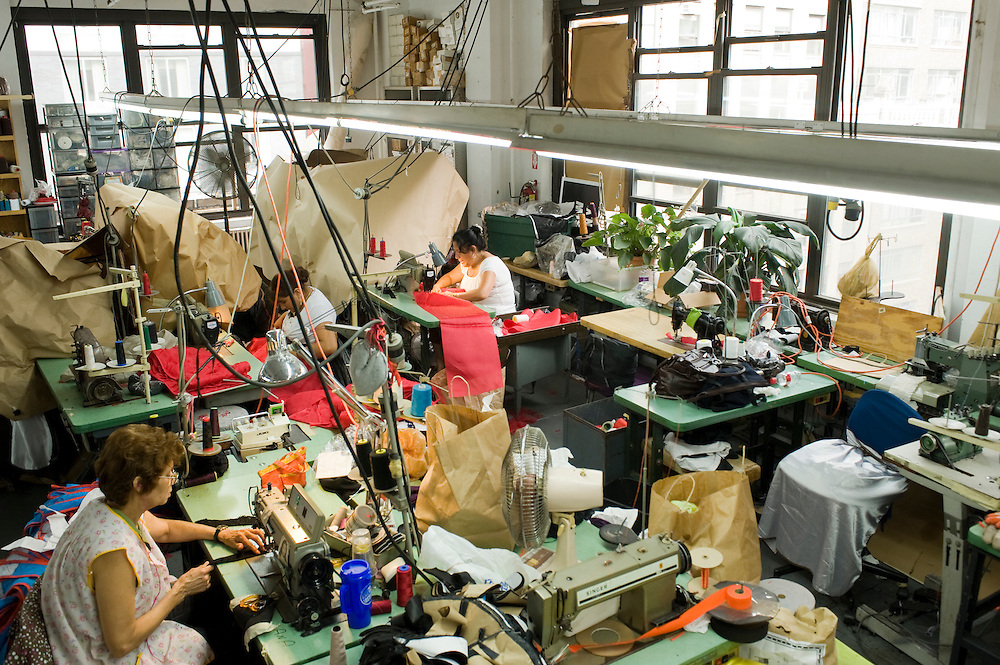 Fashion District / Garment District New York City..R&C Apparel, a clothing manufacturer in the Garment district. Most workers here are from the Dominican Republic...More than a million New Yorkers pass through Midtown every day, but few know that the neighborhood between 34th and 40th Streets, and Broadway and Ninth Avenue, houses one of the largest manufacturing clusters in New York City. In the Garment District, hundreds of small factories and suppliers work closely with designers to create the latest styles that make New York City a global fashion capital, and influence the clothes we wear every day..photo © Stefan Falke