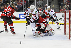 Mar 27; Newark, NJ, USA; Chicago Blackhawks right wing Patrick Kane (88) chases the loose puck after a save by New Jersey Devils goalie Martin Brodeur (30) during the first period at the Prudential Center.