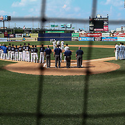 Caravel Academy and Middletown players listen to the National Anthem prior a DIAA baseball semifinal game between Caravel Academy and Middletown at Frawley Stadium Saturday May 28, 2016 in Wilmington.