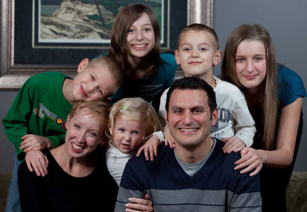 Windsor, Ontario ---11-12-16--- Essex Conservative MP Jeff Watson and his wife Sarah, pose for a photo with five children, from left, Elijah, 8, Ava, 4, Emma, 13, Thaddaeus, 7, and Sophie, 14, in their Amherstburg, Ontario home December 16, 2011 . Watson advocates for a national adoption strategy, and is working in Parliament for more uniform national policies around adoptive practices and tax supports.<br /> GEOFF ROBINS Toronto Star