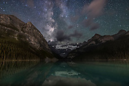 The summer Milky Way to the southwest over Victoria Glacier and Lake Louise in Banff National Park, Alberta on a moonless night, August 29, 2016. This was about midnight at the start of the night, and before a time-lapse sequence. A low-level aurora and likely airglow this night to the north added a general green cast to the sky, minimized to some extent here.<br /> <br /> Mt. Fairview to the left and others are partly illuminated by light spill from the Chateau Lake Louise and from highway lights in the valley below. <br /> <br /> This is a stack of 8 exposures for the ground, averaged to smooth noise, and one exposure for the sky, all 30 seconds at f/2 with the 20mm Sigma Art lens and at ISO 4000 with the Nikon D750. All untracked. Long Exposure Noise Reduction applied.