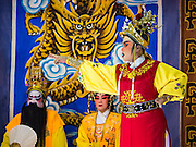 08 DECEMBER 2016 - BANGKOK, THAILAND:  A Chinese opera (also called ngiew in Thailand) performance at Pek Leng Keng Shrine in the Khlong Toei neighborhood of Bangkok. Public performances of music and celebration were banned during the first 30 days of the mourning period for Bhumibol Adulyadej, the Late King of Thailand. Now, nearly two months after the revered monarch's death, Bangkok street life is returning to normal and Chinese temples and shrines are once again scheduling operas.     PHOTO BY JACK KURTZ