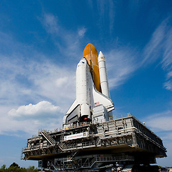 The space shuttle Discovery is rolled to launch pad 39B at the Kennedy Space Center in Cape Canaveral, Florida May 19, 2006. Discovery is scheduled for launch in July on Mission STS-121 to the International Space Station.   SCOTT AUDETTE INC/Scott Audette