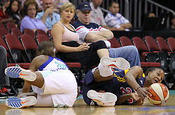 June 3, 2012; Newark, NJ, USA; Indiana Fever forward Tamika Catchings (24) and New York Liberty guard Cappie Pondexter (23) fight for a loose ball during the second half at the Prudential Center. The Liberty defeated the Fever 87-72.