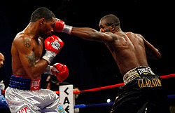 Dec 13, 2008; Atlantic City, NJ, USA; Kendall Holt (Black) and Demetrius Hopkins (Black/Gold) trade punches during their 12 round WBO Jr. Lightweight Championship bout at Boardwalk Hall in Atlantic City, NJ.  Holt won the bout via split decision.