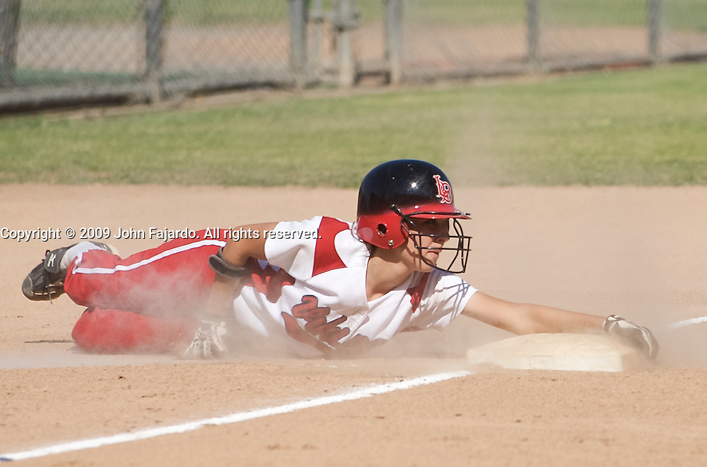 Alyssa Belmontes slides into third base in the game against Mt. SAC at the LAC softball field on Tuesday April 21, 2009.  The Vikings lose the final regular season home game 5-1.