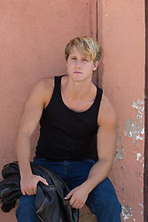 All American blond man in a tank top outdoors