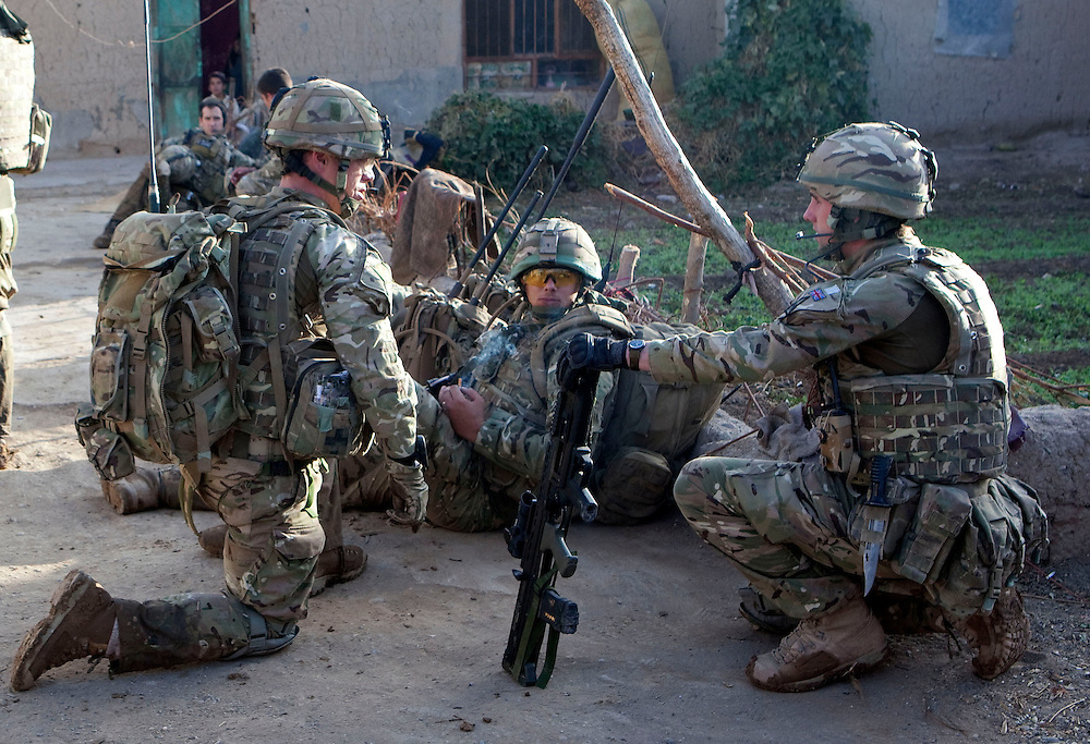 Cpl Ian Muncy (left) Cpl Chris Morrison (right) and Cpl John Goode (Medic in center) soldiers from B Coy 3 Scots and 1PWRR prepare to leave a compound during Operation Tora Pishaw aimed at disrupting insurgent activity in their AO (Area of Operations.  Minutes later as they searched a nearby compound an IED exploded severely wounding Pte Stephen Bainbridge  who lost both legs as a result of the blast. Loya Manda, Nad e Ali North, Helmand Province, Afghanistan on the 11th of November 2011.