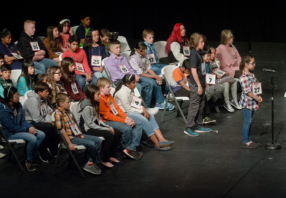Alani Skye Eugenio, right, a 4th grader from Hidalgo County, steps up to the microphone to spell a word during the 2017 New Mexico Spelling Bee at Sandia Prep, Saturday, March 18, 2017. (Marla Brose/Albuquerque Journal)