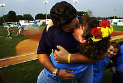 """""""I didn't do so well the first time,"""" Robert Smith said of giving his wife Karen a big kiss after renewing their vows before a Hagerstown Sun baseball game. The Hagerstwon couple has been married 15 years and have three children, including 7-year-old Michael (R) who seems surprised at his parent's smooch. Five couples participated in Renew Your Vows night at the minor league ball park."""