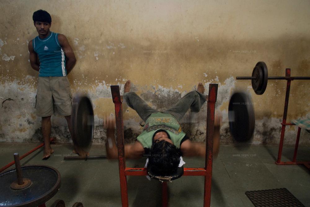 Men pump iron at the local gym. Dharavi, Mumbai, August 2007