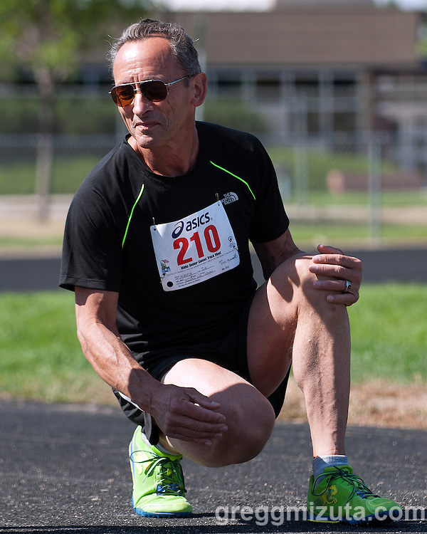 Jim Martin before the start of the 100 meter run at the Idaho Senior Games at Timberline High School in Boise, Idaho on August 3, 2013. Martin finished second in the M60 Division with a time of 18.17.