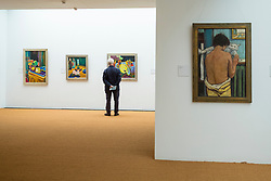 Visitor looking at paintings in Brücke Museum in Dahlem , Berlin, Germany