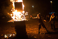 A young boy burning a Israeli flag in the orthodox distric of Mea Shearim during the Lag BaOmer celebrations. Orthodox jews are against the zionist state