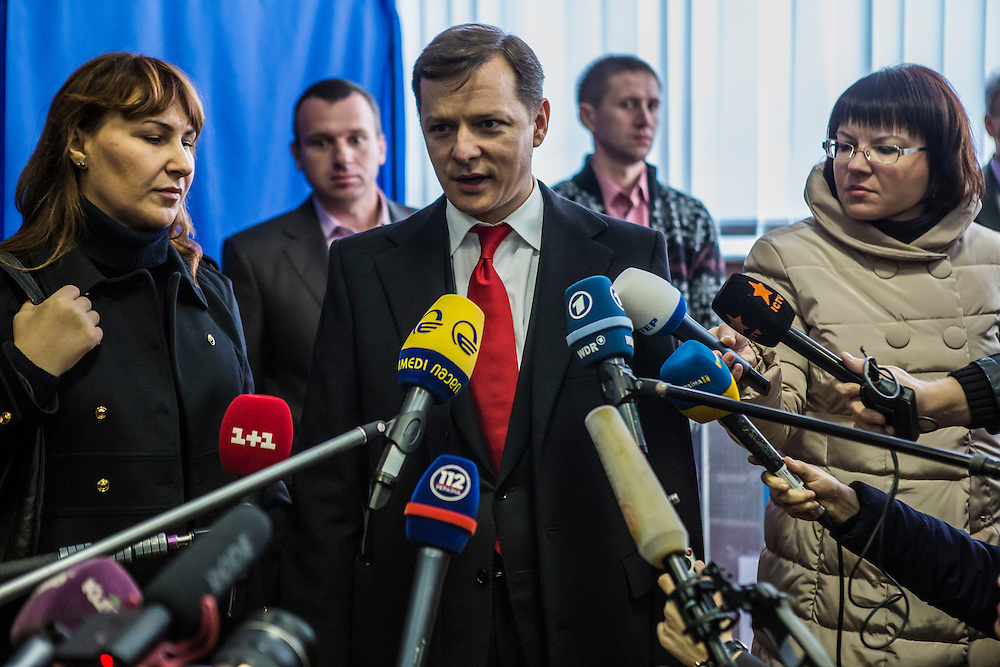 KIEV, UKRAINE - OCTOBER 26: Oleh Lyashko (C), head of Ukraine's Radical Party, speaks to reporters after casting his ballot at a polling station on October 26, 2014 in Kiev, Ukraine. The country's parliamentary elections are seen as key to President Petro Poroshenko's ability to advance his agenda. (Photo by Brendan Hoffman/Getty Images) *** Local Caption *** Oleh Lyashko;Rosita Sayranen