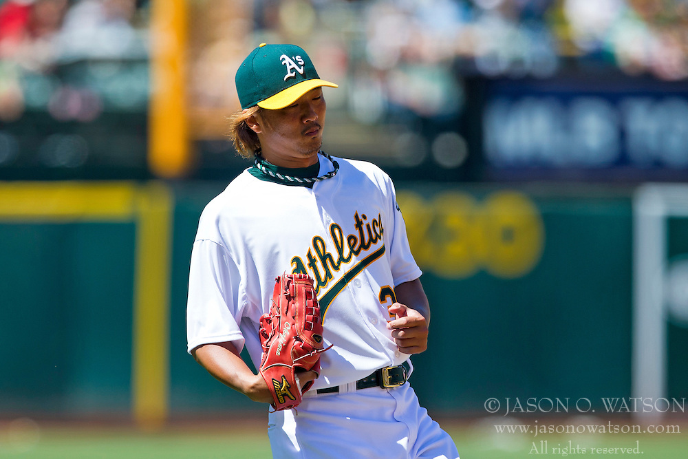 OAKLAND, CA - MAY 19: Hideki Okajima #39 of the Oakland Athletics returns to the dugout during the middle of the seventh inning against the Kansas City Royals at O.co Coliseum on May 19, 2013 in Oakland, California. The Oakland Athletics defeated the Kansas City Royals 4-3. (Photo by Jason O. Watson/Getty Images) *** Local Caption *** Hideki Okajima