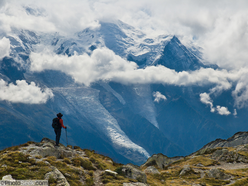 Hike the High Route (Chamonix-Zermatt Haute Route) on Aiguille Rouge massif across from glacier-covered Mont Blanc above Chamonix Valley, France, Europe.
