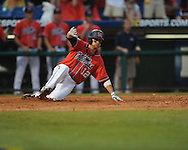 Ole Miss' Tanner Mathis (24) scores vs. Auburn's Ryan Jenkins during the Southeastern Conference tournament at Regions Park in Hoover, Ala. on Friday, May 28, 2010.  (AP Photo/Oxford Eagle, Bruce Newman)