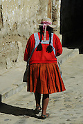 Campesino woman walking down the street in Tarabuco, Chuquisaca, Bolivia