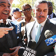 New York Governor David Paterson and New York Representative Charlie Rangel are mobbed by the media before the start of the 40th Annual African Day Parade on September 20 on Adam Clayton Powell Blvd.