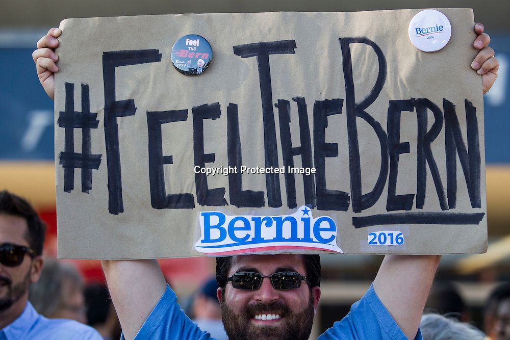 Frank Rothstein, 30, of Inland Empire, holds up a sign before a rally for democratic presidential candidate Sen. Bernie Sanders, I-Vt., Monday, Aug. 10, 2015, at the Los Angeles Memorial Sports Arena in Los Angeles. (AP Photo/Ringo H.W. Chiu)