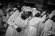 Women donning white robes dance and sing as the congregation prays during a five hour service at The Celestial Church of Christ in London, Sunday February 26, 2012. The Celestial Church of Christ in London, is associated to a pentecostal church based in Lagos, Nigeria. This congregation is one of the many  extraordinary communities hidden in the city. Snapshots of subcultures that look as though they could have been taken a million miles away from London.(Photo/Elizabeth Dalziel)