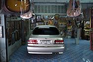 A car is kept inside a store, in Fang, Thailand. PHOTO TIAGO MIRANDA
