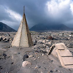 The former capital of Montserrat, Plymouth, which is now covered under a layer of ash, mud and rock from the eruption of the Soufriere Hills volcano over the last 10 years. The area is out of bounds to everyone except scientists. Photo shows destroyed church..Photo©Steve Forrest/Workers Photos