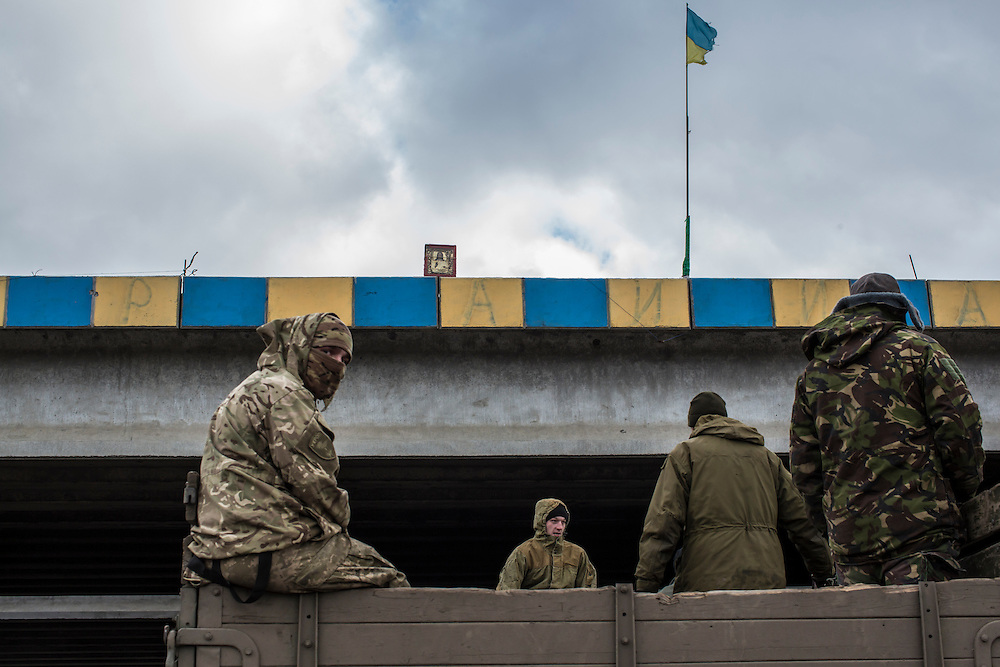 Ukrainian soldiers outside the heavily contested town of Pisky on Wednesday, February 17, 2016 in Pervomaiske, Ukraine.
