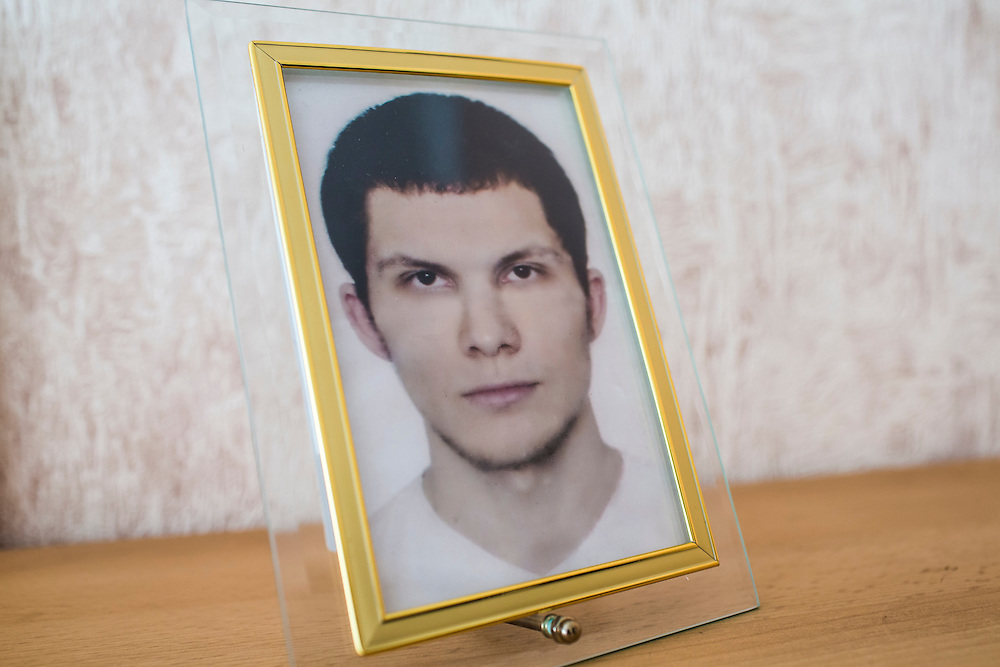 A photograph of Alexander Panin stands on a shelf in his grandmother's home, where he was mostly raised, on Tuesday, February 25, 2014 in Tver, Russia. Panin, a Russian citizen who was arrested in the Dominican Republic in June 2013, is set to be charged by federal authorities in the US with being part of a gang which robbed bank accounts via the Internet. Photo by Brendan Hoffman, Freelance
