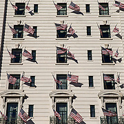 WASHINGTON, USA - January 18: American flags adorn the exterior of the Willard Hotel just days before the 58th Inauguration Ceremony where President-elect Donald Trump will be sworn into office in Washington, USA on January 18, 2017.